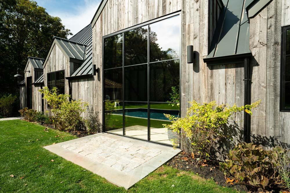 accordion glass patio doors | custom bi fold doors | luxury steel design | thin door frames | steel and glass doors | custom steel doors